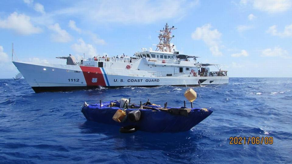 A rustic boat used by Cuban migrants to try to reach South Florida floats in front of the Coast Guard Cutter Isaac Mayo, 27 miles south of Long Key on Wednesday, June 9, 2021. A law enforcement team from the cutter interdicted 16 Cuban migrants from the craft.