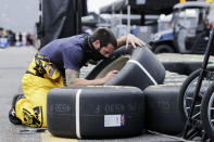 Tires are checked by a crew member for driver Erik Jones before the start of the NASCAR Cup Series auto race Sunday, May 17, 2020, in Darlington, S.C. (AP Photo/Brynn Anderson)