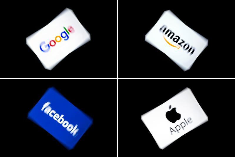 (COMBO) This combination of pictures shows the logos of the GAFA's, named after US multinational technology and Internet-related services company Google, US online retail giant Amazon, US social media Facebook and US multinational technology company Apple, displayed on a tablet in Paris, on February 18, 2019. (Photo by Lionel BONAVENTURE / AFP) (Photo credit should read LIONEL BONAVENTURE/AFP/Getty Images)