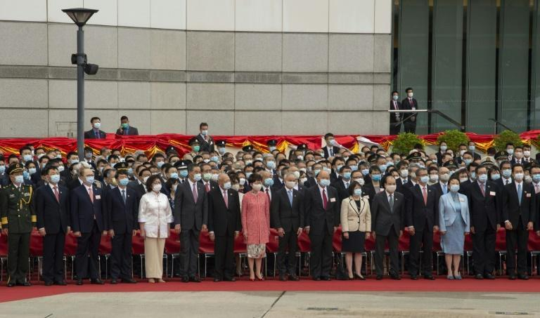 Hong Kong Chief Executive Carrie Lam and other officials attend a flag raising ceremony to mark China's National Day