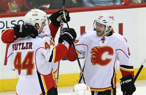 Calgary Flames' Chris Butler (44) celebrates his goal with teammate Lee Stempnail (22) during first -period NHL hockey game action against the Ottawa Senators in Ottawa, Ontario, Friday, Dec. 30, 2011. (A{P Photo/The Canadian Press, Fred Chartrand)