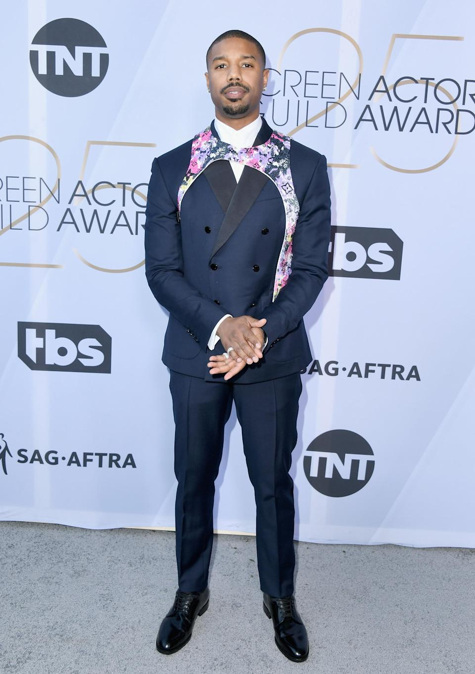 <p>Michael B. Jordan wore a Louis Vuitton custom tuxedo with a colorful embroidered harness to the 2019 Screen Actors Guild Awards in Los Angeles. (Photo: Getty Images) </p>