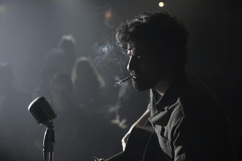 """This film image released by CBS FIlms shows Oscar Isaac in a scene from """"Inside Llewyn Davis."""" (AP Photo/CBS FIlms, Alison Rosa)"""
