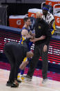 Indiana Pacers' T.J. McConnell (9) tries to settle assistant coach Greg Foster during the second half of the team's NBA basketball game against the Sacramento Kings, Wednesday, May 5, 2021, in Indianapolis. (AP Photo/Darron Cummings)