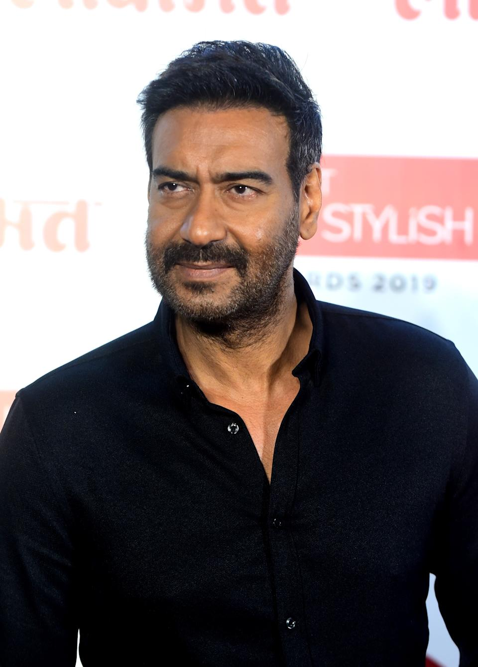 In this picture taken on December 18, 2019 Bollywood actor Ajay Devgn arrives at the Lokmat Most Stylish Awards in Mumbai. (Photo by Sujit Jaiswal / AFP) (Photo by SUJIT JAISWAL/AFP via Getty Images)