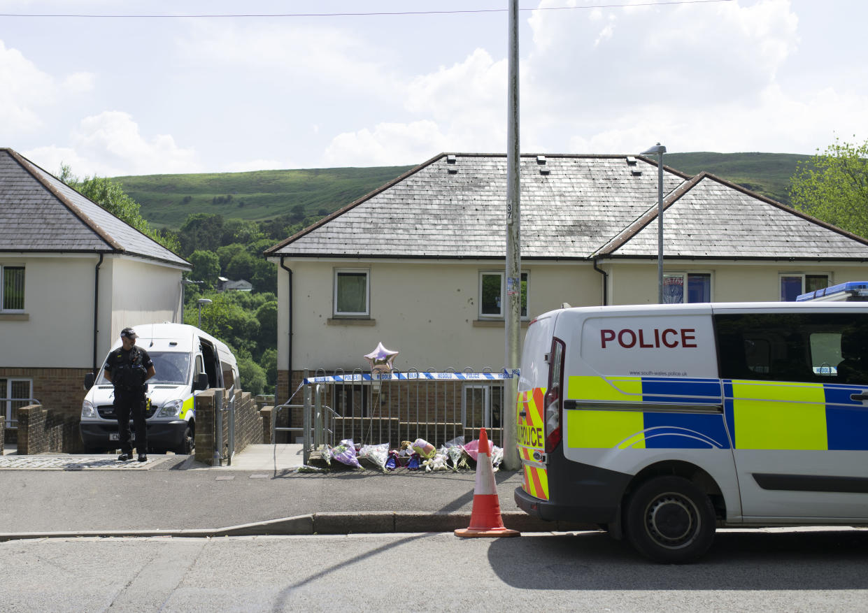 A police van stands outside the property where Amelia Brooke Harris was found dead in June (Getty Images)