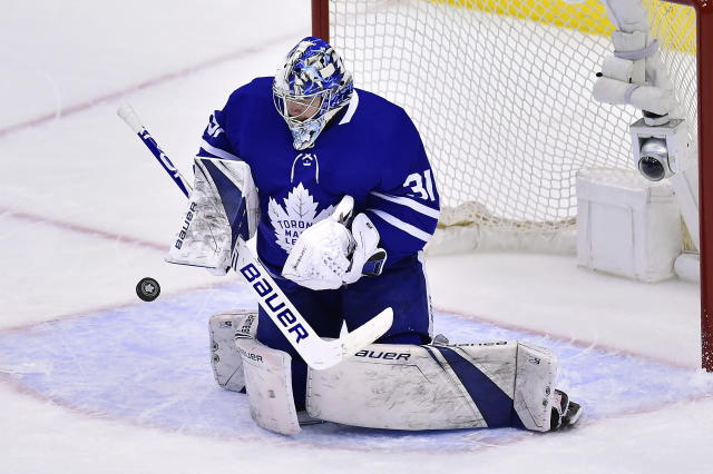 Toronto Maple Leafs goaltender Frederik Andersen (31) makes a save against the Boston Bruins during first-period NHL playoff hockey action in Toronto, Monday, April 15, 2019. (Nathan Denette/The Canadian Press via AP)