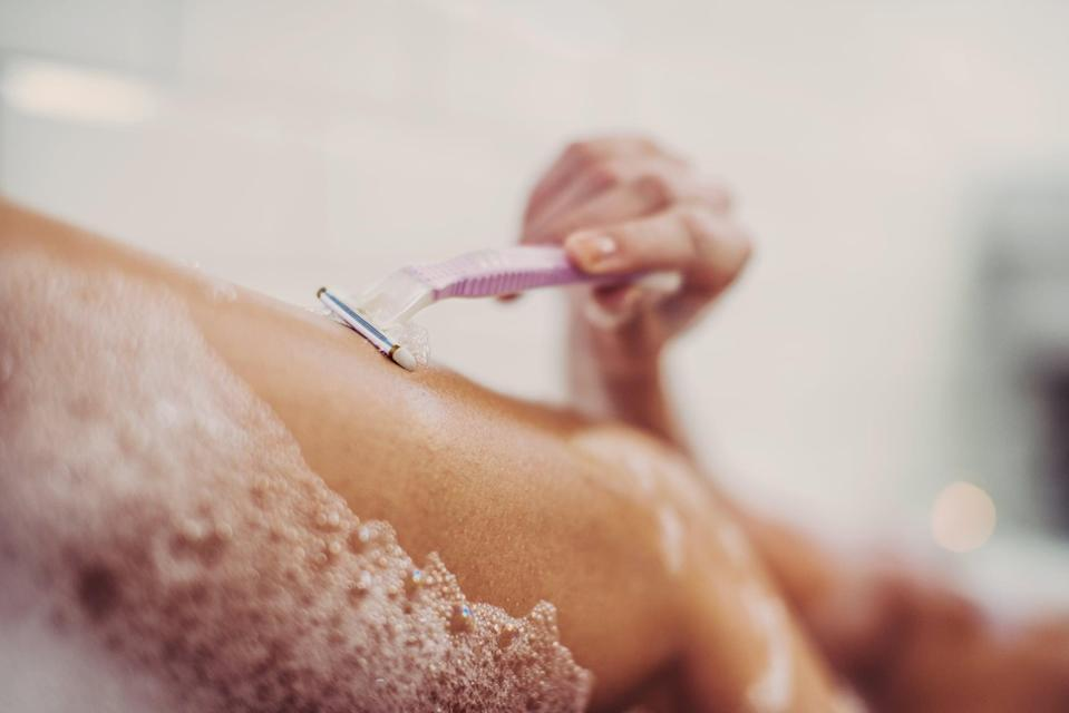 <p>Instead of shaving during your shower, which can take up a decent chunk of time all while the water is running, shave over the edge of the bathtub with the water shut off. Then, rinse your razor in the sink instead of the shower to save resources. This'll help you take shorter showers and use less water!</p>