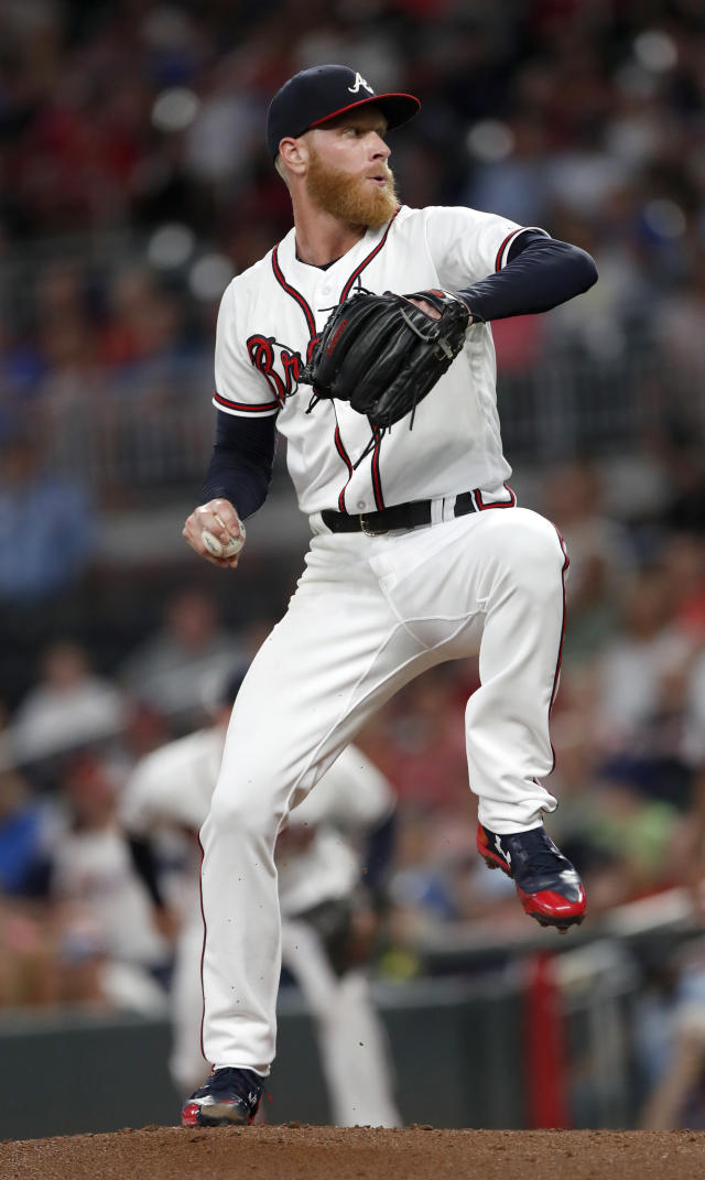 Atlanta Braves starting pitcher Mike Foltynewicz (26) works in the second inning of a baseball game against the Cincinnati Reds, Monday, June 25, 2018, in Atlanta. The Braves won 5-4 in 11 innings. (AP Photo/John Bazemore)