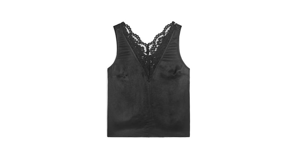 """<p>Our eye is firmly on this lacy top from Arket for out next date night. <br><a rel=""""nofollow noopener"""" href=""""https://www.arket.com/en_gbp/women/tops/product.washed-satin-top-black.0655342001.html"""" target=""""_blank"""" data-ylk=""""slk:Buy here."""" class=""""link rapid-noclick-resp"""">Buy here. </a> </p>"""
