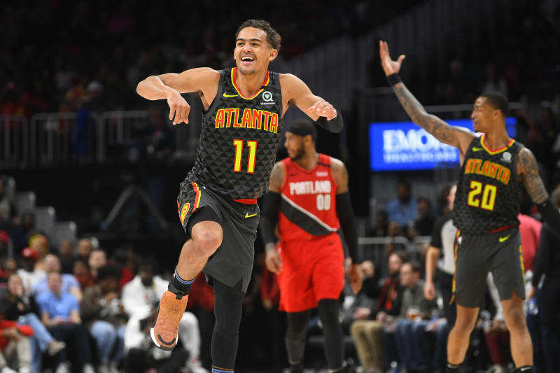 Atlanta Hawks guard Trae Young (11) reacts after a long range assist during the second half of an NBA basketball game against thePortland Trail Blazers, Saturday, Feb. 29, 2020, in Atlanta. The Hawks won 129-117. (AP Photo/John Amis)
