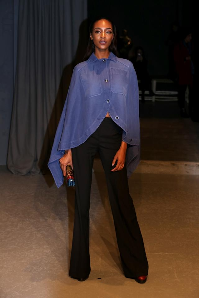 <p>Jourdan Dunn wore a chambray cape and flared trousers. <i>[Photo: PA]</i> </p>