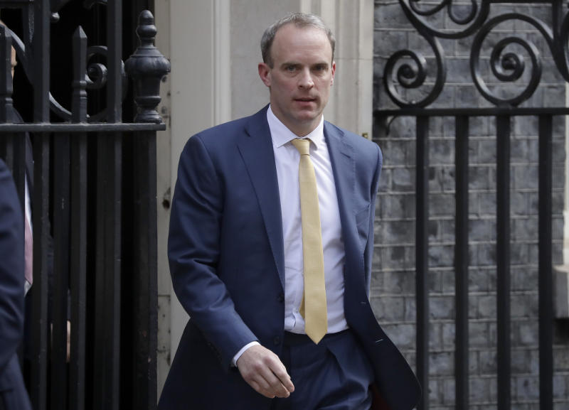 Britain's Secretary of State for Foreign Affairs, Dominic Raab, left, leaves 10 Downing Street after a meeting as British Prime Minister Boris Johnson was moved to intensive care after his coronavirus symptoms worsened in London, Tuesday, April 7, 2020. Johnson was admitted to St Thomas' hospital in central London on Sunday after his coronavirus symptoms persisted for 10 days. Having been in hospital for tests and observation, his doctors advised that he be admitted to intensive care on Monday evening. The new coronavirus causes mild or moderate symptoms for most people, but for some, especially older adults and people with existing health problems, it can cause more severe illness or death.(AP Photo/Matt Dunham)