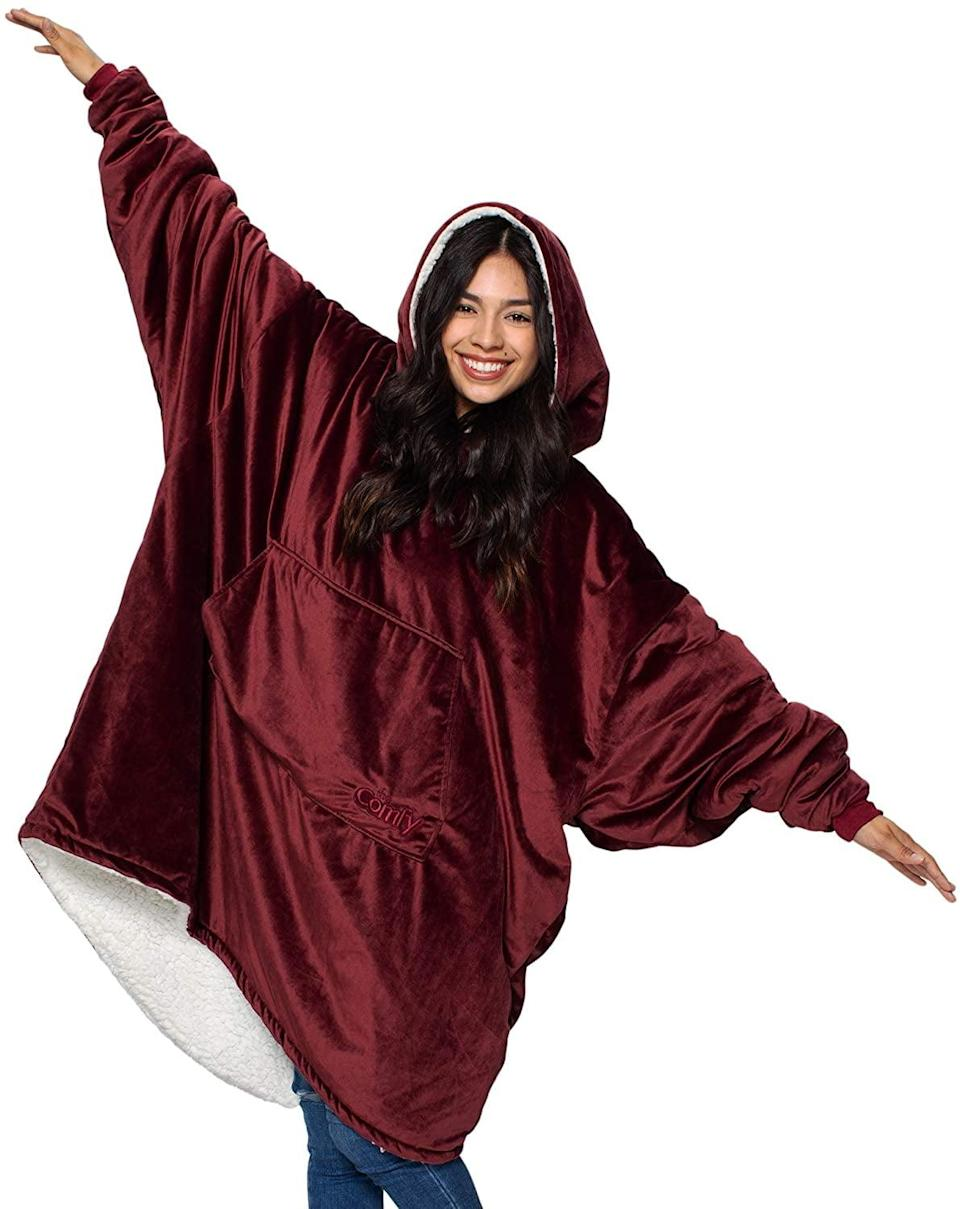 <p>If they are all about the cozy vibes and enjoying a movie night rather than going out on a Saturday night, they'll absolutely obsess over the <span>The Comfy Original</span> ($45). The oversize microfiber and soft sherpa wearable blanket comes in a variety of colors.</p>