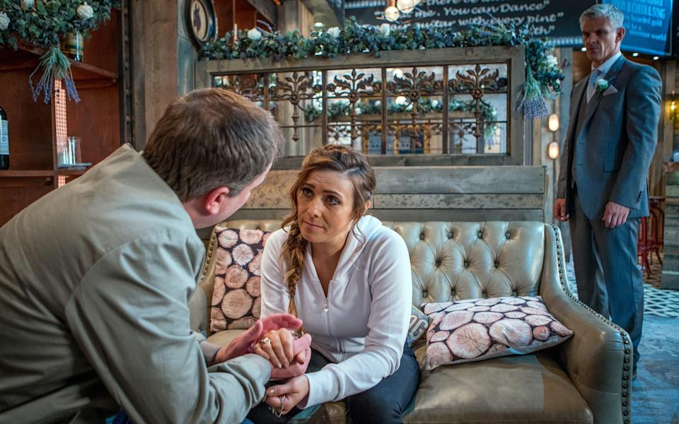 <span>Steve McDonald, as played by Simon Gregson, approaches Michelle Connor, as played by Kym Marsh, and tells her about Robert Preston's, as played by Tristan Gemmill, steroid abuse and heart attack. </span>(REX)
