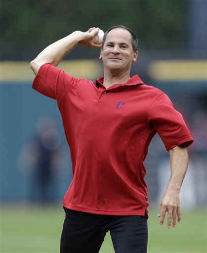 Former Cleveland Indians' Omar Vizquel throws out the ceremonial first pitch before the Indians play the Detroit Tigers in a baseball game, Saturday, July 6, 2013, in Cleveland. (AP Photo/Tony Dejak)