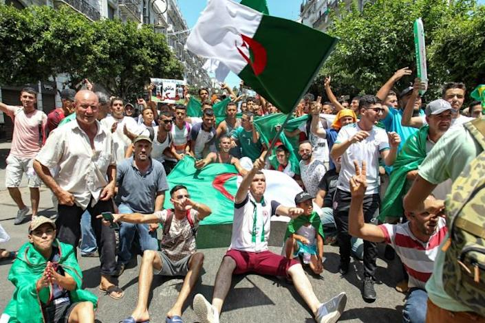 Algerians were back on the streets Friday for anti-government protests boosted by anticipation as the national team prepares to battle Senegal in Cairo in the Africa Cup of Nations final (AFP Photo/-)