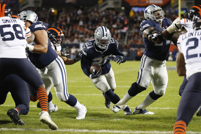 Dallas Cowboys running back Ezekiel Elliott (21) runs for a touchdown during the first half of an NFL football game against the Chicago Bears-, Thursday, Dec. 5, 2019, in Chicago. (AP Photo/Charles Rex Arbogast)