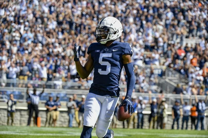 FILE - Penn State wide receiver Jahan Dotson (5) celebrates his first quarter touchdown catch against Villanova during an NCAA college football game in State College, Pa., in this Saturday, Sept. 25, 2021, file photo. The key matchup in fourth-ranked Penn State's showdown with No. 3 Iowa pits the Nittany Lions' passing combo of Sean Clifford and Jahan Dotson against a defense that leads the nation with 12 interceptions. (AP Photo/Barry Reeger, File)