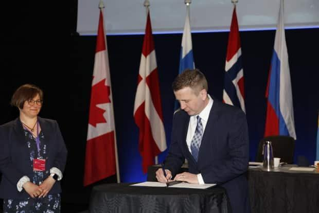 Icelandic Minister for Foreign Affairs and International Development Cooperation Gudlaugur Thór Thórdarson signing the Reykjavik Declaration outlining the work Iceland has done over the past two years and the future commitments of the Arctic Council.