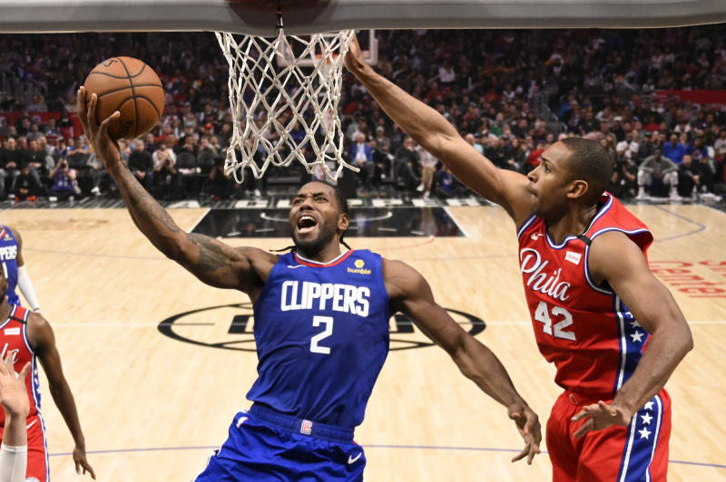 Los Angeles Clippers forward Kawhi Leonard, left, shoots as Philadelphia 76ers forward Al Horford defends during the second half of an NBA basketball game Sunday, March 1, 2020, in Los Angeles. The Clippers won 136-130. (AP Photo/Mark J. Terrill)