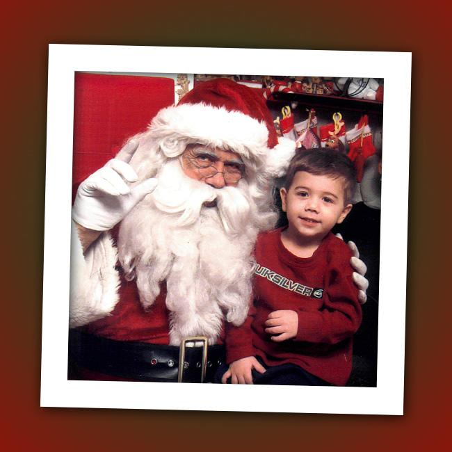 We're thinking this little guy probably didn't ask Santa for a little sister. Who is that on Santa's lap?