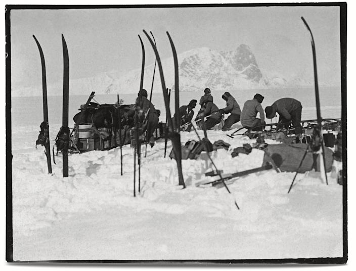 """Foundering in soft snow: Bowers' sledge team; Wilson pushing; Oates and PO Evans repairing, Beardmore Glacier, 13 December, 1911.<br><br>(Photo credit: ©2011 Richard Kossow)<br><br>For more information on """"The Lost Photographs of Captain Scott"""" and where to buy the book, visit <a href=""""http://www.hachettebookgroup.com/books_9780316178501.htm"""" rel=""""nofollow noopener"""" target=""""_blank"""" data-ylk=""""slk:hachettebookgroup.com"""" class=""""link rapid-noclick-resp"""">hachettebookgroup.com</a>"""