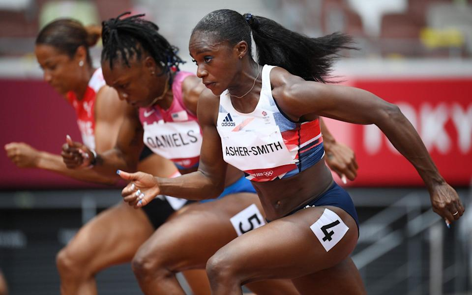 Dina Asher-Smith of Great Britain competes during round one of the Women's 100m heats - Matthias Hangst/Getty Images