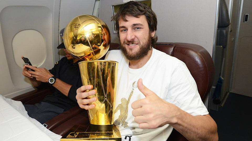 Andrew Bogut is pictured with the NBA Larry O'Brien championship trophy in 2015.