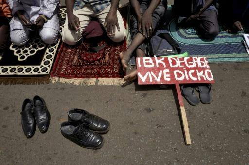 Muslim protesters pray in Independence Square. The placard reads 'IBK out, long live Dicko,' referring to President Ibrahim Boubacar Keita and Imam Mahmoud Dicko, who has risen to challenge him