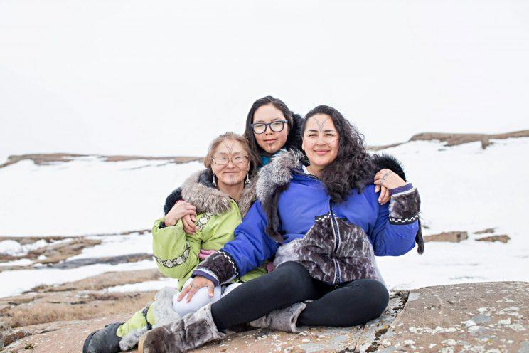 """<p>""""That is Millie Angulalik on the far left (from Cambridge Bay, Nunavut) the first facial tattoo I did. Janelle Angulalik (from Kugluktuk, Nunavut) who is the youngest girl I tattooed (13 years old) sitting with me (far right) during a photoshoot for our tattoo book,"""" Johnston said. Photo from Cora DeVos/Little Inuk Photography</p>"""