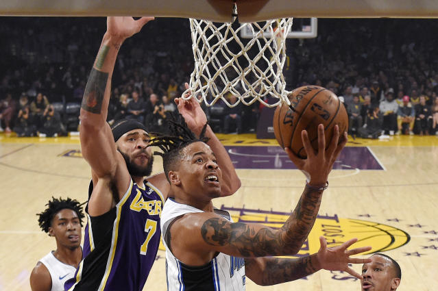 Orlando Magic guard Markelle Fultz, right, shoots as Los Angeles Lakers center JaVale McGee defends during the first half of an NBA basketball game Wednesday, Jan. 15, 2020, in Los Angeles. (AP Photo/Mark J. Terrill)