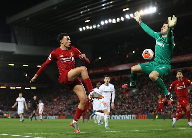 Trent Alexander-Arnold (left) helped set up two of Liverpool's goals in a 3-2 win over West Ham on Monday. (Photo by Clive Brunskill/Getty Images)