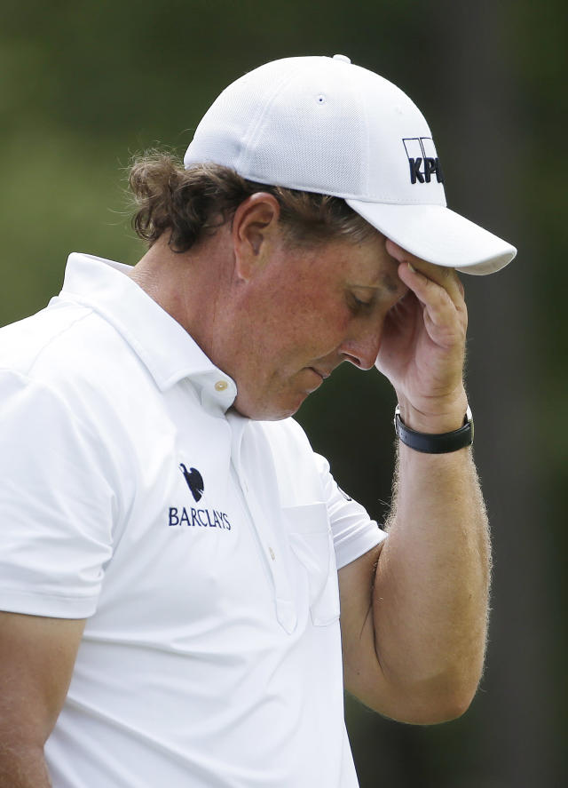 Phil Mickelson reacts to his tee shot on the ninth hole during the third round of the U.S. Open golf tournament in Pinehurst, N.C., Saturday, June 14, 2014. (AP Photo/David Goldman)