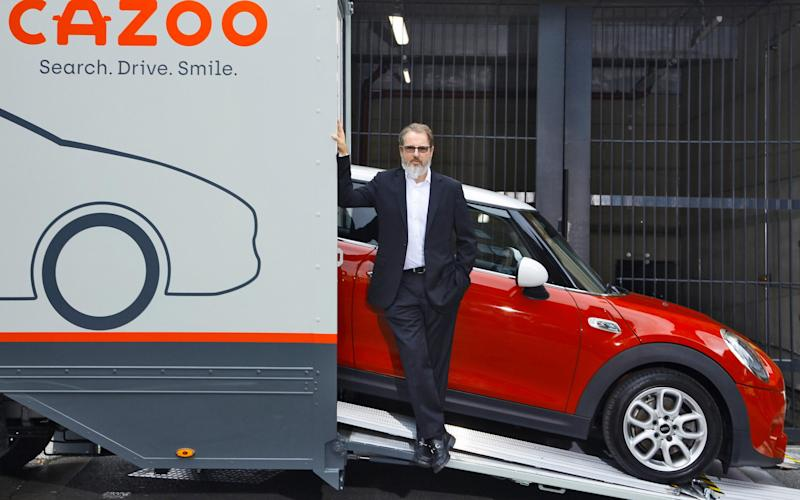 Alex Chesterman, founder of Zoopla and Cazoo, with Cazoo transporter - Tom Stockill/Cazoo