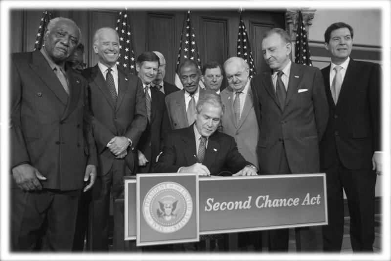 President George W. Bush, center, signs the Second Chance Act in 2008. (Photo: Gerald Herbert/AP; digitally enhanced by Yahoo News)