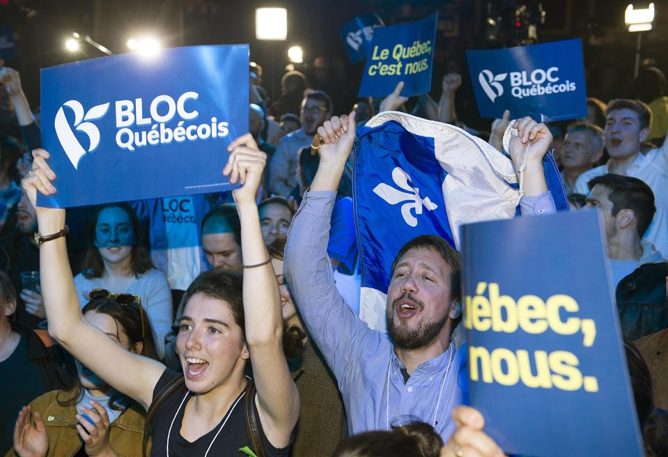 Bloc Quebecois supporters react as results come in on federal election night in Montreal, Monday, October 21, 2019. THE CANADIAN PRESS/Graham Hughes