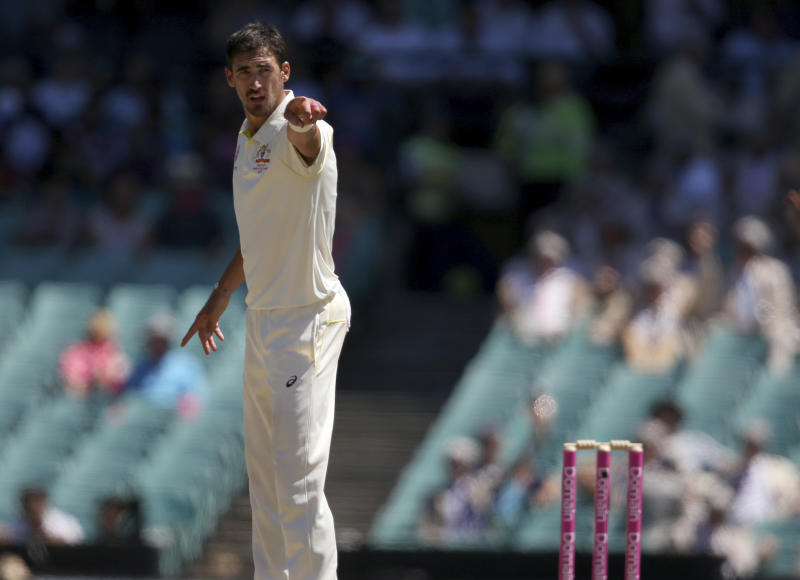 Australia's Mitchell Starc points at the umpire to appeal for a LBW decision against India on day 2 during their cricket test match in Sydney, Friday, Jan. 4, 2019. (AP Photo/Rick Rycroft)