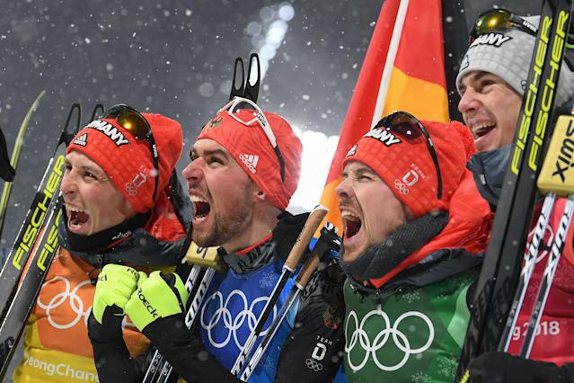 <p>Germany's Johannes Rydzek, Vinzenz Geiger, Fabian Riessle, and Eric Frenzel celebrate winning gold during the Nordic Combined Team Gundersen LH/4x5km, Cross-Country at the 2018 Winter Olympic Games in PyeongChang, South Korea, February 22, 2018.<br> (Photo by Christof Stache/AFP/Getty Images) </p>