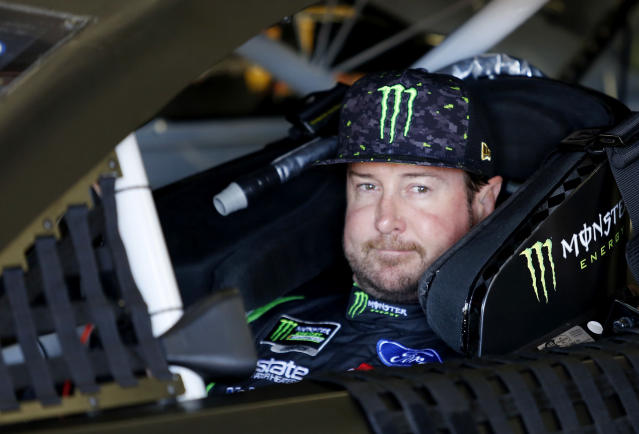 "FILE – In this July 20, 2018, file photo, <a class=""link rapid-noclick-resp"" href=""/nascar/sprint/drivers/156/"" data-ylk=""slk:Kurt Busch"">Kurt Busch</a> waits in his car before NASCAR Cup Series auto racing practice at New Hampshire Motor Speedway in Loudon, N.H. NASCAR's driver carousel will spin long after the season finale. Former Cup champions Busch and <a class=""link rapid-noclick-resp"" href=""/nascar/sprint/drivers/81/"" data-ylk=""slk:Matt Kenseth"">Matt Kenseth</a>, and <a class=""link rapid-noclick-resp"" href=""/nascar/sprint/drivers/3574/"" data-ylk=""slk:Daniel Suarez"">Daniel Suarez</a>, <a class=""link rapid-noclick-resp"" href=""/nascar/nationwide/drivers/1245"" data-ylk=""slk:AJ Allmendinger"">AJ Allmendinger</a>, <a class=""link rapid-noclick-resp"" href=""/nascar/sprint/drivers/930/"" data-ylk=""slk:Regan Smith"">Regan Smith</a> and <a class=""link rapid-noclick-resp"" href=""/nascar/sprint/drivers/191/"" data-ylk=""slk:Jamie McMurray"">Jamie McMurray</a> are among the drivers certain to start next season with new teams or new roles. (AP Photo/Mary Schwalm, File)"