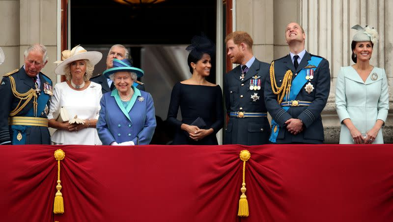 FILE PHOTO: Britain's Queen Elizabeth is joined by members of the Royal Family on the balcony of Buckingham Palace as they watch a fly past to mark the centenary of the Royal Air Force in central London