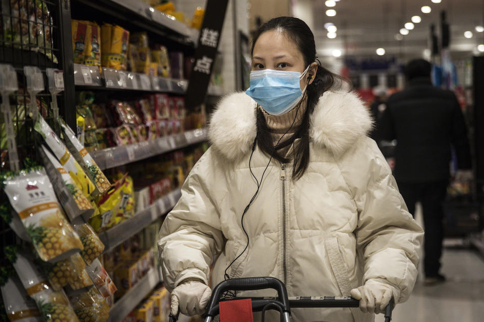 WUHAN, CHINA - FEBRUARY 12:  (CHINA OUT) A woman wears a protective mask as she shops in the supermarket on February 12, 2020 in Wuhan, Hubei province, China. Flights, trains and public transport including buses, subway and ferry services have been closed for 21 days. The number of those who have died from the Wuhan coronavirus, known as 2019-nCoV, in China climbed to 1117.  (Photo by Stringer/Getty Images)