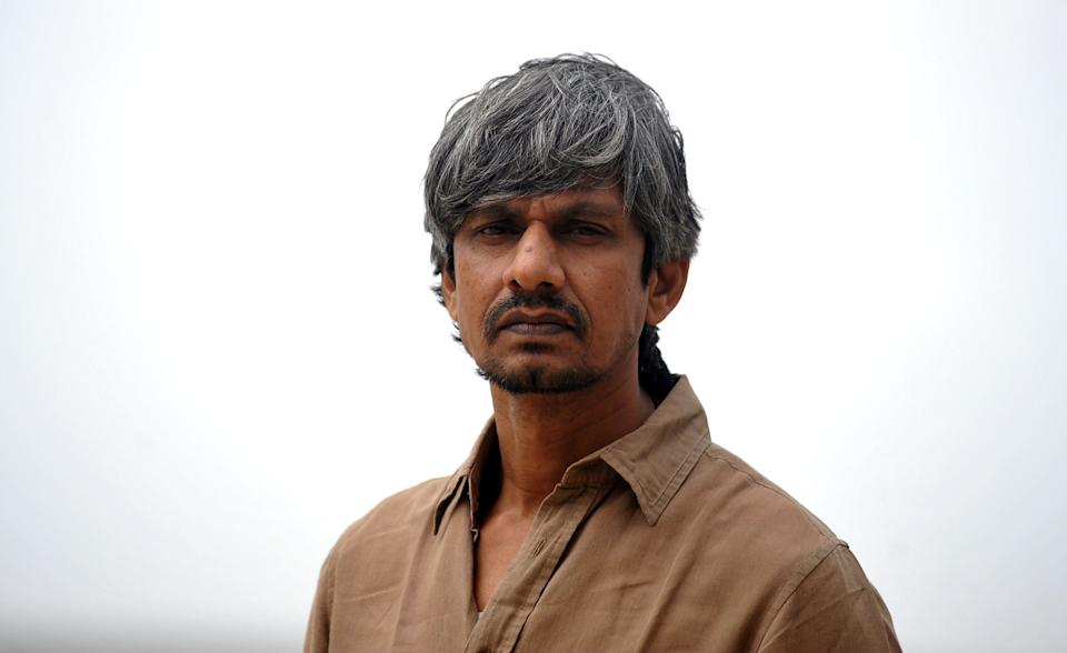 Indian Bollywood actor Vijay Raaz takes part in a promotional event for upcoming Hindi comedy film Bankey Ki Crazy Baarat in Mumbai on July 20, 2015. AFP PHOTO        (Photo credit should read STR/AFP via Getty Images)