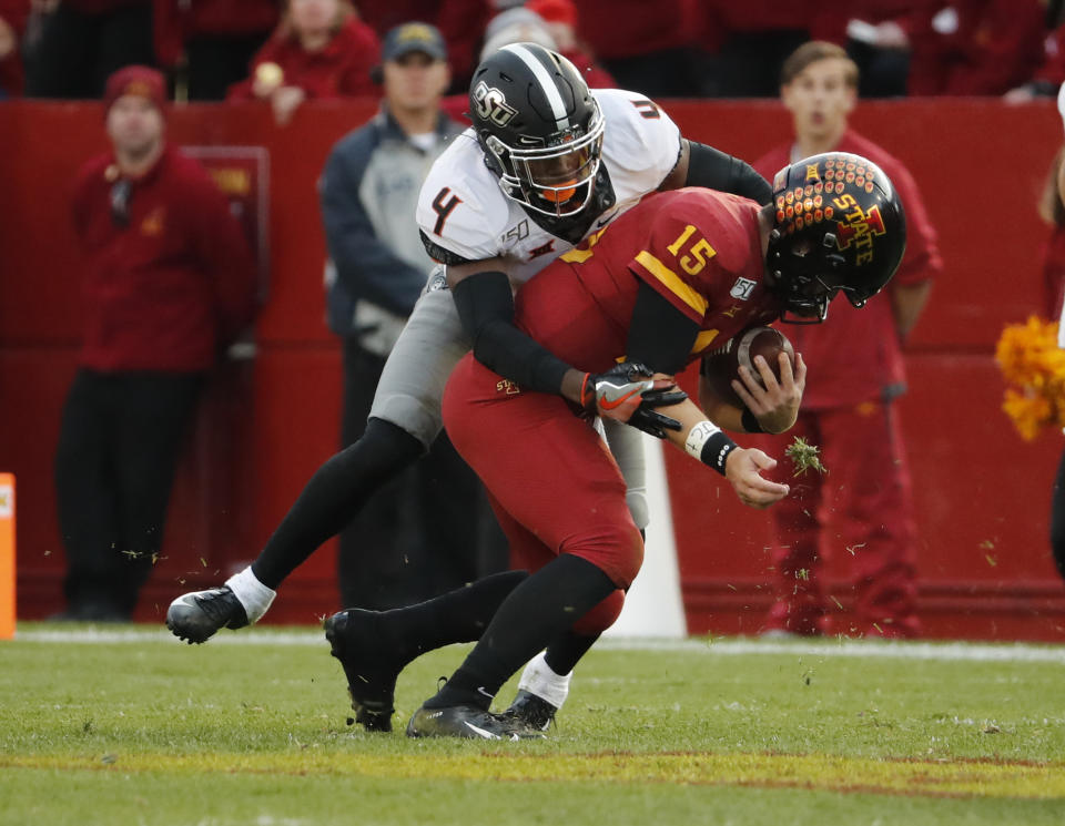 AMES, IA - OCTOBER 26: Cornerback A.J. Green #4 of the Oklahoma State Cowboys tackles quarterback Brock Purdy #15 of the Iowa State Cyclones as he scrambled for yards in the second half of play at Jack Trice Stadium on October 26, 2019 in Ames, Iowa. The Oklahoma State Cowboys won 34-27 over the Iowa State Cyclones.(Photo by David Purdy/Getty Images)