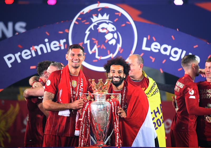 Liverpool's Dejan Lovren (left) and Mohamed Salah celebrate with the Premier League trophy after the Premier League match at Anfield, Liverpool. (Photo by Laurence Griffiths/PA Images via Getty Images)