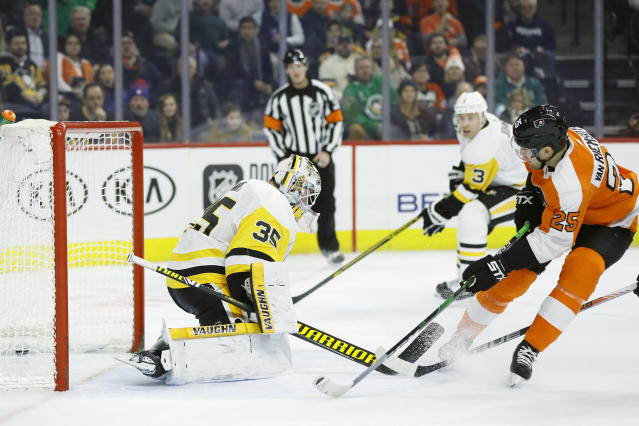 Philadelphia Flyers' James van Riemsdyk, right, scores a goal past Pittsburgh Penguins' Tristan Jarry during the second period of an NHL hockey game, Tuesday, Jan. 21, 2020, in Philadelphia. (AP Photo/Matt Slocum)