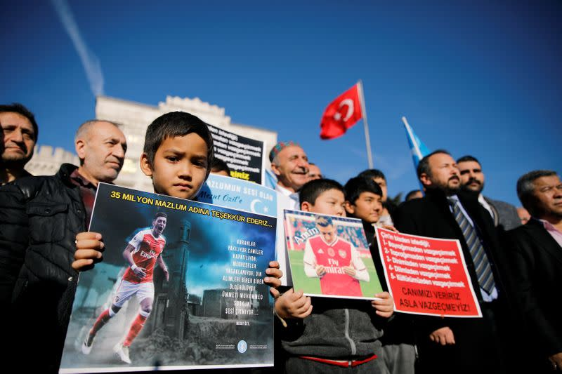 Ethnic Uighur demonstrators attend a protest against China in Istanbul