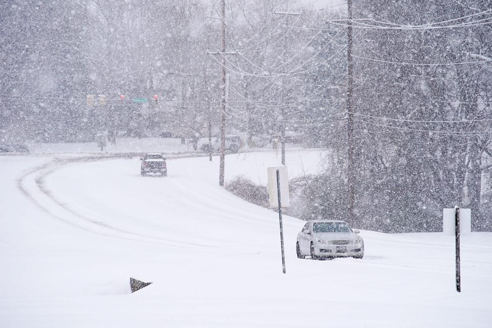 Cars drive on Two Rivers Parkway in Nashville, Tenn., Thursday, Feb. 18, 2021. Snow continued to fall on the Nashville area on Thursday further contributing to challenging driving conditions.