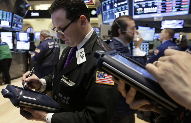 Trader Edward Curran, left, works on the floor of the New York Stock Exchange, Friday, Feb. 28, 2014. U.S. stocks are opening higher, pushing the market further into record territory. (AP Photo/Richard Drew)
