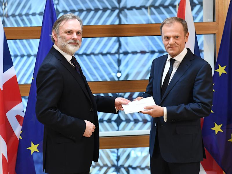 British ambassador to the EU, Sir Tim Barrow delivers the official notice under Article 50 of the Lisbon Treaty to European Council President Donald Tusk in Brussels, Belgium: EPA